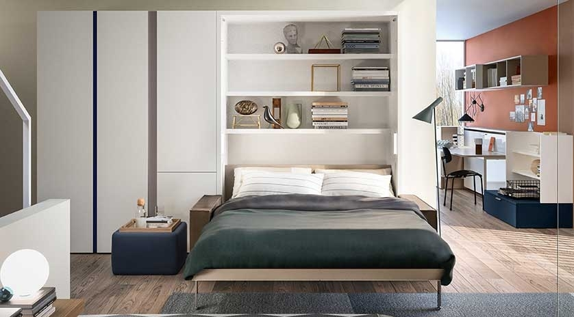 Mueble cama de matrimonio con sofá para pisos pequeños.